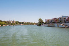 View of Guadalquivir river in Seville. With Triana district and Torre del Oro stock images