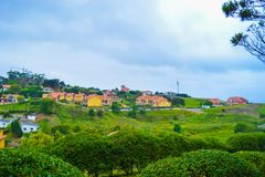 View of Guell y Martos park, with houses at the background, in C. Omillas, Cantabria, Spain Royalty Free Stock Images