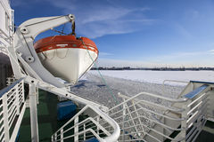 View from the Gulf of Finland covered with ice on St. Petersburg seaport and a lifeboat from a vessel in the foreground. Russia Stock Image