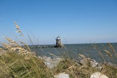View of Gulf of Mexico at Dauphin Island in Alabama. A view of the Gulf of Mexico at Dauphin Island in Alabama.  Surrounded by rocks and sea oats with a view of Stock Photo