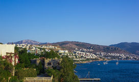 View of the Gumbet Bay. Mountainous terrain near the Aegean Sea. Typical buildings on the mountain near the sea. Bodrum. Turkey Royalty Free Stock Images