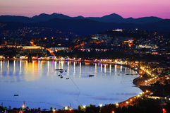 View of Gumbet Bay by night. Turkish Riviera Royalty Free Stock Photography