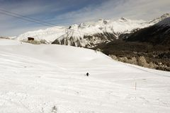 A view of a guy skiing in the alps switzerland in winter.  Royalty Free Stock Photos