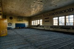 Derelict Gymnasium - Abandoned Saint Philomena School, East Cleveland, Ohio. A view of a gymnasium inside the historic Saint Philomena School in East Cleveland Stock Photo