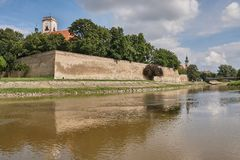 View in Gyor from the Raba river. With castle wall reflecting on the water Stock Images