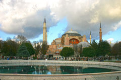 View of the Haghia Sophia church in Istanbul. Dramatic autumn view of Haghia Sophia church in Istanbul, Turkey with fountain and rain clouds in background Royalty Free Stock Photos
