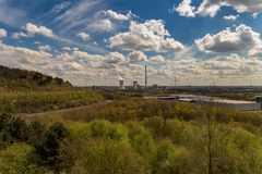 View from Halde Hoheward, Herten, Germany. View over a cloudy Recklinghausen, seen from from Halde Hoheward, Ruhr Area, North Rhine-Westfalia, Germany stock photos