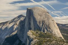 Half Dome Seen From Glacier Point. A view of Half Dome and the Yosemite valley from Glacier Point in Yosemite National Park in California stock photos