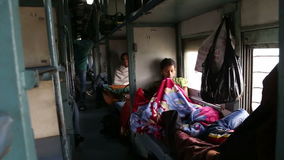 View on hall with people in train beds during a train ride. JODHPUR, INDIA - 13 FEBRUARY 2015: View on hall with people in train beds during a train ride stock video