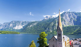 View on Hallstatt with tower church, lake and mountain, Austria Stock Photos