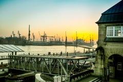 View of Hamburg city and port. Hamburg, Germany - FEBRUARY 15, 2017: view of Hamburg port and river Elba at sunset Stock Image