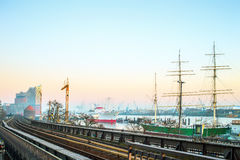 View of Hamburg city and port. Hamburg, Germany - FEBRUARY 15, 2017: view of Hamburg port and river Elba at sunset Royalty Free Stock Photos