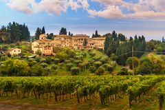 View on Fonterutoli on sunrise. It is hamlet of Castellina in Chianti in province of Siena. Tuscany. Italy. View on hamlet Fonterutoli on sunrise. It is old royalty free stock photo