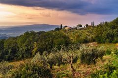 View on Fonterutoli on sunrise. It is hamlet of Castellina in Chianti in province of Siena. Tuscany. Italy. View on hamlet Fonterutoli on sunrise. It is old royalty free stock photography