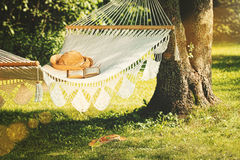 View of hammock and book  on a summer day Stock Photo