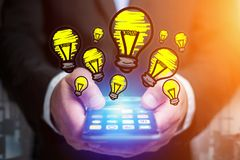 Hand drawn bulb lamp icon going out a smartphone interface of a. View of Hand drawn bulb lamp icon going out a smartphone interface of a businessman at the Royalty Free Stock Photo