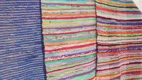 View of handmade carpets made of old stuff. View of handmade carpets made of old colourful stuff stock footage