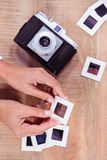 View of hands holding photo slides Stock Photos