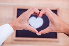 View of hands making heart shape Stock Photo
