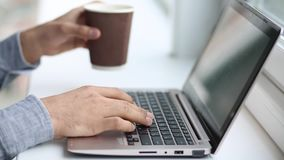 View of hands typing on computer. Businessman working on laptop in the office stock footage