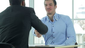View of a handshake while two successful stock video footage