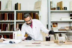 Handsome mature engineer working in laboratory in the furniture Stock Photos
