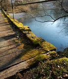 A view from the hanging bridge to the river. stock image