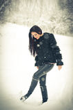 View of happy brunette girl playing with snow in winter landscape. Beautiful young female on winter background. Attractive woman Royalty Free Stock Images