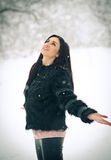 View of happy brunette girl playing with snow in winter landscape. Beautiful young female on winter background. Attractive woman Stock Images