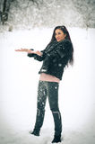 View of happy brunette girl playing with snow in winter landscape. Beautiful young female on winter background. Attractive woman Stock Image