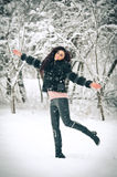 View of happy brunette girl playing with snow in winter landscape. Beautiful young female on winter background. Attractive woman Royalty Free Stock Photos