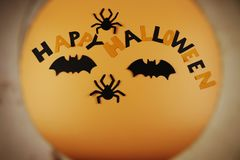 A view on Happy Halloween sign through some light pipe. Scare is ready. Children have magic clothes. Comon and scaring. Im afraid. Orange background royalty free stock photography