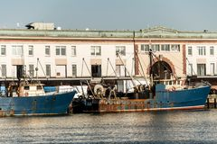View of harbor from the Boston Waterfront with fishing boat trucks and boats anchored Massachusets stock photo