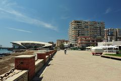 View of Harbor of Durres, Albania. View from the harbor of Durrës, Albania against apartment buildings and hotels.  Large walking area in front of horizontal Royalty Free Stock Image