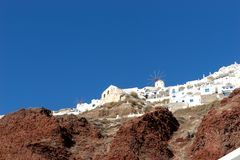 View from the harbor on Oia, a beautiful village on the volcanic island of Santorini Stock Photo