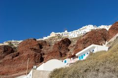 View from the harbor on Oia, a beautiful village on the volcanic island of Santorini Royalty Free Stock Images