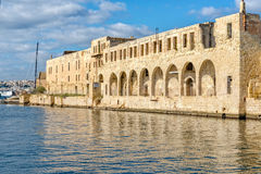 View of a harbor in Valletta, Malta. The old, ramshackle building overlooking the sea, Valletta marina Royalty Free Stock Photo