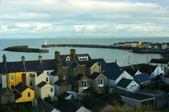 A view of the harbour and lighthouse at the County Down village of  Donaghadee in Northern Ireland. Taken across the rooftops from the Moat Stock Photography