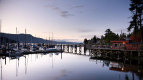 View of harbour and marina at Brentwood Bay, BC, at sunset Royalty Free Stock Photography