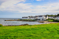 View of harbour and town Port Charlotte on Isle of Islay Royalty Free Stock Image
