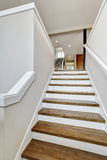 View of hardwood stairs to second floor. Stock Photos