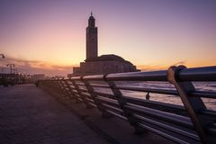 View of Hassan II mosque from the walk alley at the Sunset Royalty Free Stock Photo