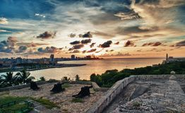 View of havana city and bay at dusk. Beautiful view of the city of Havana and its bay at sunset in Cuba Stock Photography