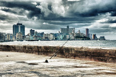 View of Havana city skyline and waterfront by the ocean. Aka `El Malecon` with stormy clouds Stock Photography