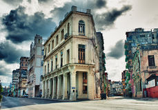 View of Havana street with typical architecture and colonial bui. Ldings against dramatic storm clouds Stock Image