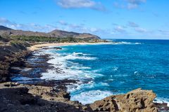 View of the Hawaiian beach and ocean during daylight. A view of the Hawaiian beach and ocean during daylight stock photos