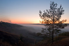 View of hazy distance with hills and sunrise Royalty Free Stock Image