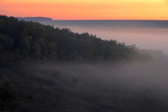 View of hazy distance with hills and sunrise Stock Photo
