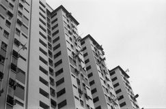 View of HDB Apartments. A view of Singapore's HDB apartments from outside. Laundry poles stick out of some windows Royalty Free Stock Photography