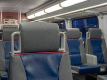 A view of a headrest on a commuter subway train with space to th Royalty Free Stock Photos
